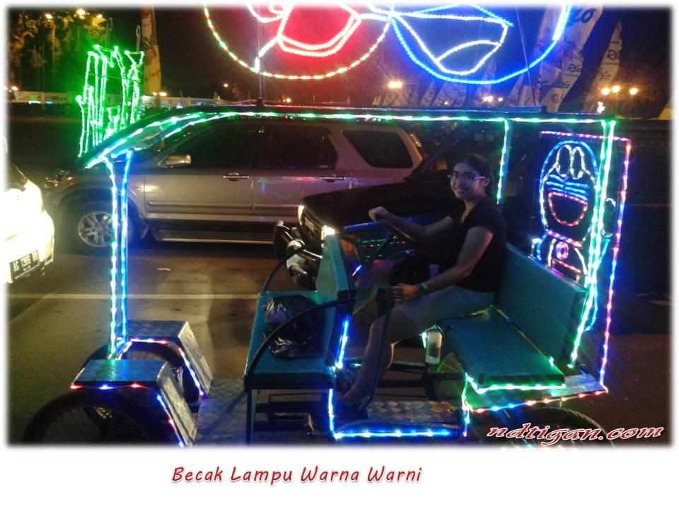Becak Lampu warna warni